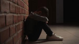 Boy desolate sitting on ground